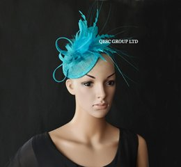 Turquoise blue Small feather fascinator sinamay fascinator for Kentucky Derby or wedding.