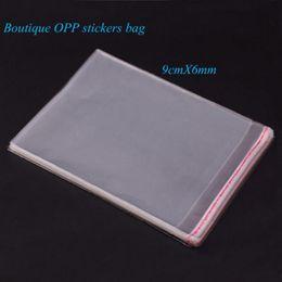 Pequeñas bolsas de plástico adhesivo transparente en venta-Envío libre boutiques de alta calidad de 200pcs Mini bolsas pequeñas de plástico para la joyería 9 cm * 6cm bolsa de auto-adhesivo del sello de OPP Paquete