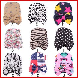 Wholesale 2016 Newest Fashion Colors Newborn Infant baby caps with big bows Lepoard Zebra Stare pattern warm hat for winter colors choose free
