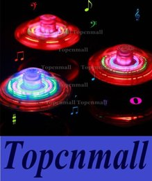 Wholesale LED Flashing Light UFO Spinning SpinTop Beyblade Gangnam Style Music Laser rotating TOP Wind Up Kids Toy Christmas Party Decor