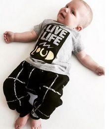 Wholesale NWT Cute Cartoon Live Life Loud Baby Girls Boys Outfits Set Summer Sets Boy Cotton Tops Harem Pants Suits Kid Checker Shirts