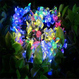 Купить Онлайн Цветковые деревья-50 Leds Solar Power Peach Blossom Фары Прозрачная форма цветка украшения Xmas Tree Light Бесплатная доставка DHL # SS-01