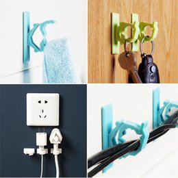 Wholesale Door after seamless adhesive hook bathroom wall clothes hanging hook clothing hanging folder electrical wire storage rack