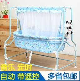 Wholesale Multifunctional baby full electric cradle bed hammock fully automatic intelligent cradle swing preschool crib band mosquito net