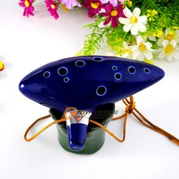 Wholesale DHL hot The Legend of Zelda Ocarina of Time Clay Ceramic Alto C Occarina holes with musical composition J010703