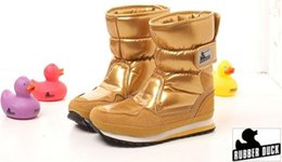 Botas para la nieve pato mujeres en Línea-Mujeres Botas Invierno 2014 Pato De Goma De La Marca De La Nieve Brillante Botas De Patente,Señoras Zapatos De Invierno Impermeable Botas De Oro