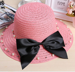 Femmes top perle en Ligne-Hot Sale Summer Beach Hat Sun Shade Grand Brimmed Chapeaux Bowknot Pearl Holiday Femmes Clean Tourism Straw Solid Caps