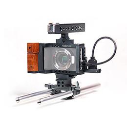 2017 aparejo de jaula Koolertron aparejo de DSLR con Top Mango Mango vídeo jaula Sistema de Blackmagic cámara de bolsillo aparejo de jaula oferta