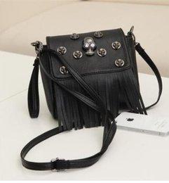 In the spring of 2015 new fashion leisure bag bag Korean tassel nail skull bag