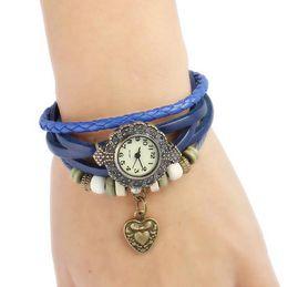 Descuento cuero reloj pulsera corazón Las pulseras coloridas hechas a mano pendientes de las pulseras del cuero del reloj de las mujeres de la manera rebordean el envío libre al por mayor de la pulsera de los encantos de las cuerdas