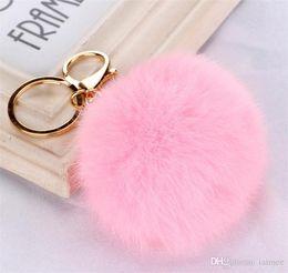 Wholesale 100pcs colors lovely CM Genuine Leather Rabbit fur ball plush key chain for car key ring Bag Pendant car keychain