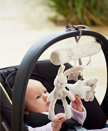Wholesale Rabbit baby music hanging bed safety seat plush toy Hand Bell Multifunctil Plush Toy Stroller Mobile Gifts asterisk playing a song
