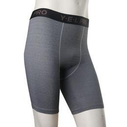 Descuento capas base Venta al por mayor-Venta superior para los deportes bajos de la compresión de la capa de los hombres que funcionan con los pantalones cortos S-XXL de los pantalones del gimnasio Pantalones cortos