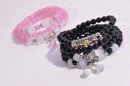 Wholesale The cat s eye cherry bracelet black agate powder Creative fashion more hand string Fashion bracelet