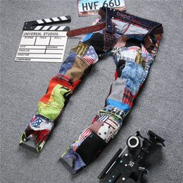 2016 New Famous brands biker jeans for men Mens Personality Patchwork Spliced Ripped Denim Jeans ,Male Fashion Colored Patch Straight Pants