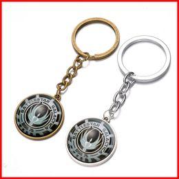 Wholesale Raphael angel battlestar galactica keychain cabochon Time gem key ring keyring pendants men women handbags hang Bronze silver