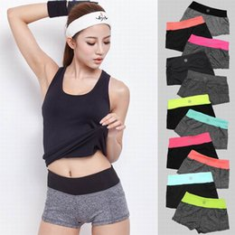 Wholesale hot sale elasticity fitness sports low waist shorts running shorts quick drying machinery pocket sport shorts women