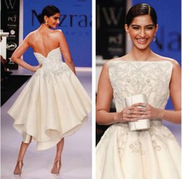 Wholesale Night sexy and charming luxury crystal bead amazing Bollywood Actress Studio Couture Backless Asymmetrical Off white Embroidery evening dres