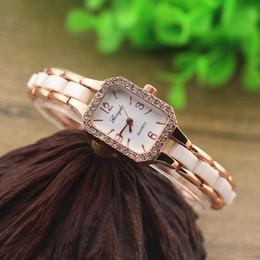Free shipping!copy ceramic metal band,gold plate alloy rectangle case wtih rhinestone deco,gerryda fashion woman lady quartz ceramic watches