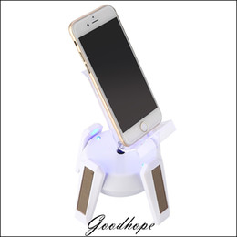Wholesale New Solar Powered Jewelry Phone Watch Rotating Display Stand Holder Turn Table with LED Light Cruve Presentation Showcase