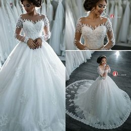 2016 Romantic Sheer Long Sleeves Wedding Dresses Sheer Neck Lace Appliques Sequins A Line Ball Gown Bridal Gowns Custom Made Wedding Gowns
