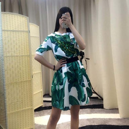 Wholesale HIGH QUALITY New Fashion Runway Summer Outfit Women Short Sleeve Banana Leaf Print Sequined T Shirt Casual Skirt Set