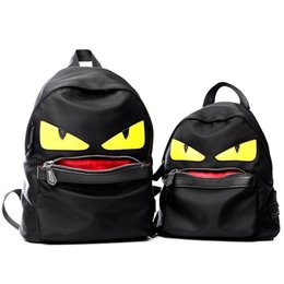 Wholesale The New Trend of Nylon Backpacks Big Eyes Small Monster Shoulder bag Schoolbag Female Male Chest Pack