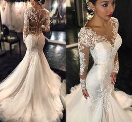 Sexy Mermaid Wedding Dresses Sheer Neck Appliques Lace Tulle Long Sleeves Arabic Wedding Gowns See Through Back
