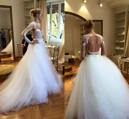 Modest White Long Sleeves Wedding Dresses Cheap Scoop Lace Appliques Open Back Beach Bridal Dress Ball Gowns Sheer Tulle Vestido De Noiva
