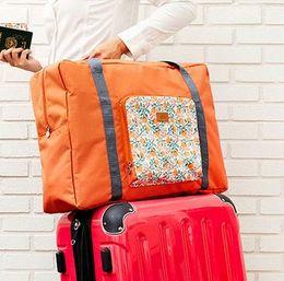 Wholesale Folding travelling bag Sleeve rod Super large capacity Portable airplane luggage bag Portable travel boarding package Storage bag