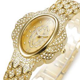 Wholesale Las joyas de oro relojes de cuarzo del nuevo del estilo de señora reloj de cuarzo resistente al agua aleación de acero inoxidable reloj de