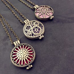 Wholesale Sunflower Locket Can Open Pierced Filigree Antique Bronze Essential Oil Aroma Diffuser Necklace with Colorful Pads in stock