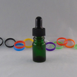 DHgate New Green 5ML Circular Glass Dropper Bottles E Liquid Round Glass Bottle With ChildProof Caps Wholesale