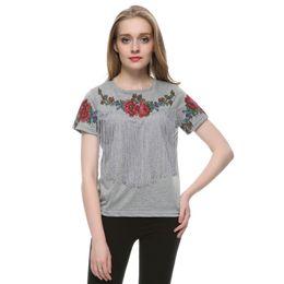 Promotion imprimé floral t-shirts femmes Femmes Tassel imprimé floral T-shirt vintage rouge rose T-shirt O cou manches courtes blusa féminine casual mince