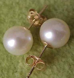 Charming a pair of 10-11mm south seas white pearl earrings 14K gold