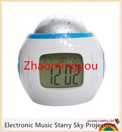 Wholesale LED Alarm Clock Battery Operated Electronic Music Starry Sky Projection Desktop alarm Clocks with Calendar for Children Kids
