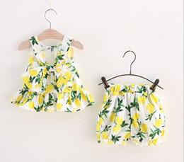 Wholesale muchachas del verano del limón trajes últimas camisetas sin mangas del chaleco de la ropa de diseño popular del bebé shorts de los niños de algodón se adapte con el arco grande