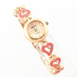 Free shipping!heart design metal band,gold plate alloy round case,gold dial,gerryda fashion woman lady bracelet quartz watches