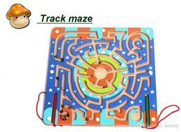Circular orbit carrying wooden maze. Intellectual development of children's educational toys. Beads game slide.