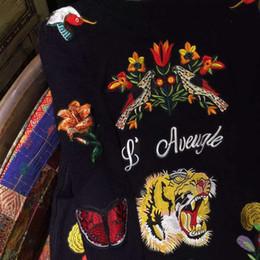 Noir cardigan tricoté à vendre-2016 femmes de la mode Sports occasionnels manteau des hommes à manches longues chandail Pulls Retour le tigre noir fleur de broderie long cardigan tricoté