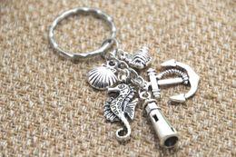 Wholesale 12pcs Beach Keychain fish anchor lighthouse seashell seahorse charm Key Ring Jewelry silver tone