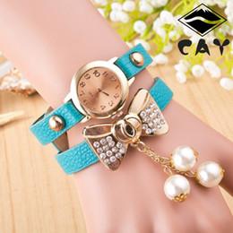 Montres de gros perle en Ligne-Gros-luxe plaqué or rose bowknot perle pendentif longue bande de cuir 6 couleurs Cristal Montres Bracelet Horloge pour femmes Mesdames Femme