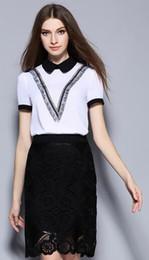 Verano Nueva muñeca tipo V borla camisa + paquete de encaje de cadera de manga corta media falda conjunto de mujeres vestido de tamaño casual S-XL desde tipos de pantalones cortos para las mujeres proveedores