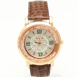 Free shipping!PVC leather band,gold plate round case,moving crystal deco under glass,quartz movement,Gerryda fashion woman lady watches,781