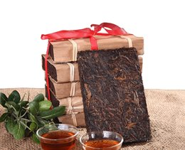 Wholesale China Yunnan pu er ripe tea brick g made in ansestor antique pu er tea brick wrapped by bamboo leaves