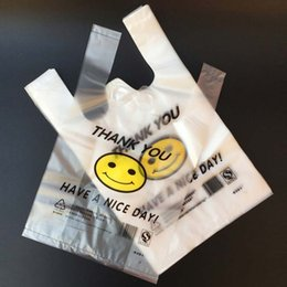 Portable 100pcs lot Smiling Face Supermarket Yellow Lovely Vest Plastic Carrier Shopping Hand Bag Packaging Bags New Fashion Bag