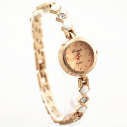 Wholesale alloy metal band with crystal deco gold plate round case gold dial gerryda fashion woman lady quartz bracelet watches