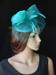 Turquoise blue sinamay fascinator wedding hat with sinamay loops feathers veiling silk flower for Royal Races Kentucky derby.