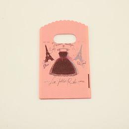 Wholesale Los bolsos de compras plásticos rosados del bolso del regalo de la impresión de la torre Eiffel con los bolsos de la joyería del punto del vestido de la manija liberan el envío
