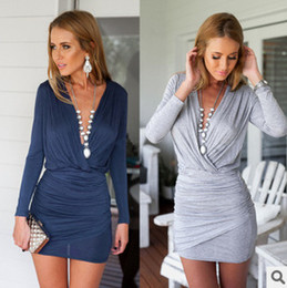 Wholesale Europe and the United States women s fashion slim sexy V neck long sleeved bag hip cross color dress